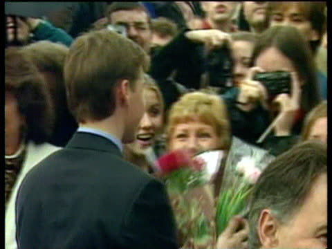Prince William accepts flowers from admiring girls lining route of walkabout Canada 20 Jun 98