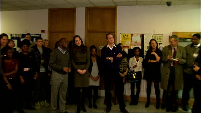 Prince William and Kate Duchess of Cambridge visit Centrepoint in Camberwell Various of William and Kate entering room and watching slide show...
