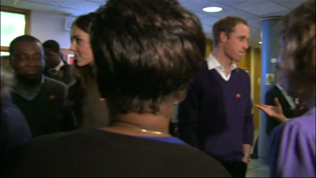 Prince William and Kate Duchess of Cambridge visit Centrepoint in Camberwell Duke and Duchess of Cambridge stand with group of young residents for...