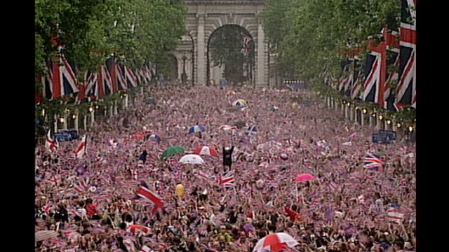 prince william and kate middleton engagement details of wedding day revealed tx crowd of people along at the queen's golden jubilee celebrations... - golden jubilee stock videos & royalty-free footage