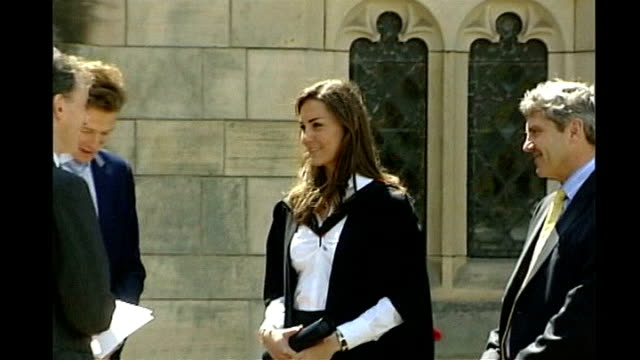 prince william and kate middleton split up; lib scotland: fife: st andrews university: ext middleton, prince william and others at their graduation... - st. andrews scotland stock videos & royalty-free footage