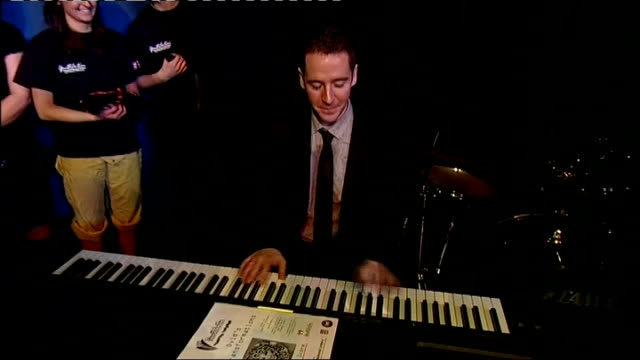 prince william and kate middleton visit belfast youth action northern ireland event man playing keyboard sot - nordirland stock-videos und b-roll-filmmaterial