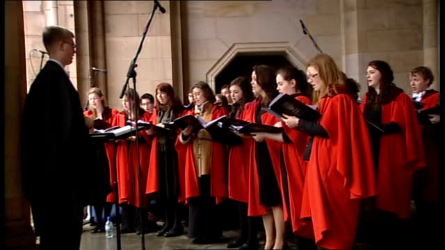 prince william and kate middleton visit st andrews university tour of museum scotland fife st andrews university int choir singing in red gowns sot - evening gown stock videos & royalty-free footage