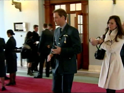 prince william and kate middleton walk down corridor at raf cranwell - royal air force stock-videos und b-roll-filmmaterial