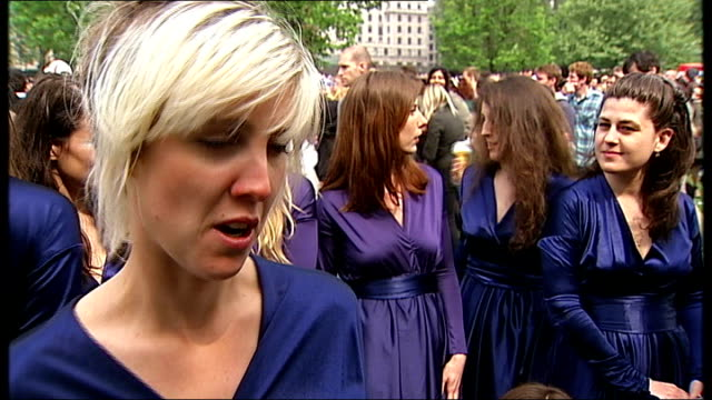prince william and kate middleton wedding day crowds and street parties woman wearing cardboard crown singing from royal wedding programme as amongst... - neckwear stock videos and b-roll footage