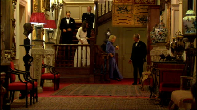 Prince William and Kate Middleton wedding day main events ENGLAND London Clarence House INT Prince Charles along down staircase followed by Camilla...