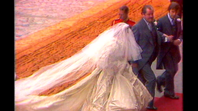 Prince William and Kate Middleton wedding Dress designer speculation LIB High angle views of Princess Diana arriving at St Paul's Cathedral in her...