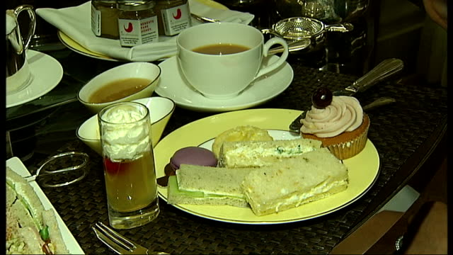 prince william and kate middleton wedding london tourism preparations england london athaeneum hotel int various close shots of hotel dining table... - afternoon tea stock videos & royalty-free footage