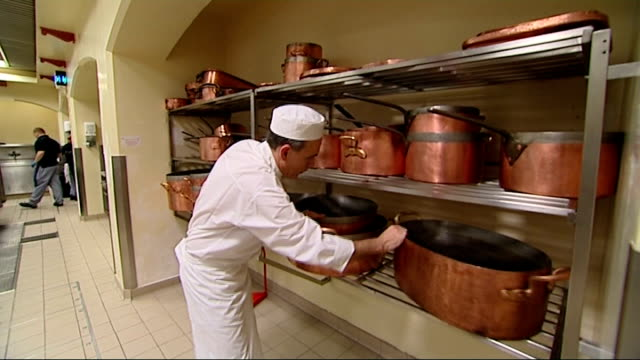 prince william and kate middleton wedding: preparations at buckingham palace kitchens and state rooms; close shot of prawns on tray / chef working /... - britisches königshaus stock-videos und b-roll-filmmaterial