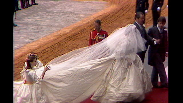 prince william and kate middleton wedding: speculation sarah burton will design wedding dress; lib st paul's cathedral: princess diana arriving at st... - wedding dress stock videos & royalty-free footage
