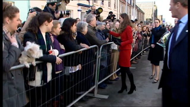 prince william and kate middleton wedding speculation sarah burton will design wedding dress lib fife st andrews ext kate middleton shaking hands... - st andrews bay stock videos & royalty-free footage