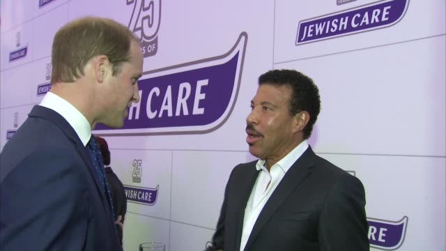 prince william and lionel richie attend jewish care charity event singer lionel richie chatting with baron levy at event / gvs prince william meeting... - lionel richie stock videos & royalty-free footage
