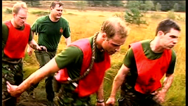 prince william and other soldiers taking part in exercise that involves carrying a heavy log over muddy and waterlogged terrain prince william... - military training stock videos and b-roll footage