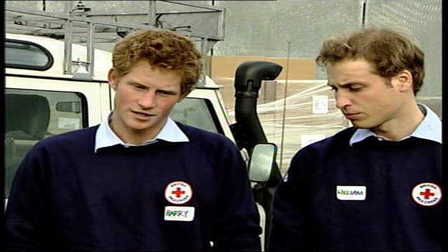 prince william and prince harry help pack aid supplies; england: gloucestershire: warmley: ext prince william interview sot - both seriously shocked... - orphan stock videos & royalty-free footage