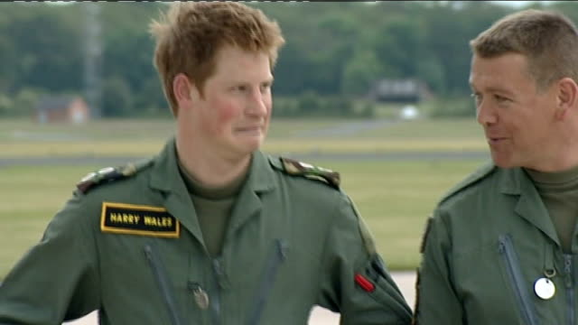 Prince William and Prince Harry interview at RAF Shawbury ENGLAND Shropshire RAF Shawbury EXT Prince Harry emerges from aircraft hangar on to...