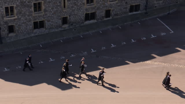 prince william and prince harry walking together along with the rest of the royal family, as they make their way back to windsor castle after the... - resting stock videos & royalty-free footage
