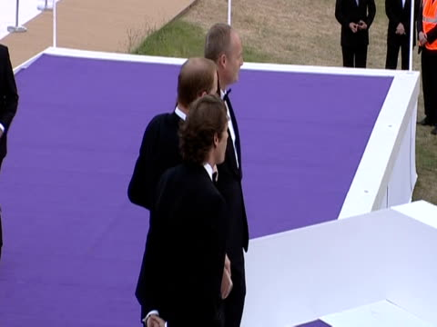 prince william and the duchess of cambridge arrive at the ark 10th anniversary gala dinner and pose for photographers - evening gown stock videos & royalty-free footage