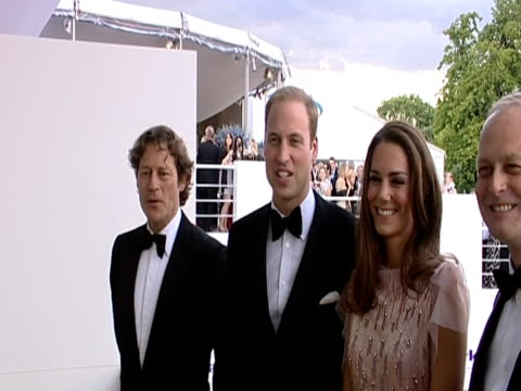 prince william and the duchess of cambridge arrive at the ark 10th anniversary gala dinner and pose for photographers - ark stock videos and b-roll footage