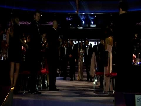 stockvideo's en b-roll-footage met prince william and the duchess of cambridge enter the ballroom at the ark 10th anniversary gala dinner. - avondjurk