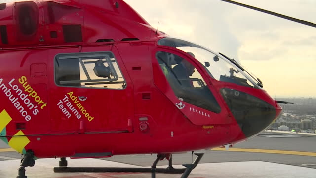 prince william arrivng by air ambulance and chatting on helipad during his visit to london's air ambulance charity at royal london hospital - helicopter landing pads stock videos and b-roll footage