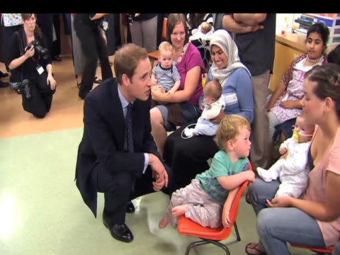 prince william attempts to comfort restless toddler at day centre during visit to new zealand 19 january 2010n - 2010 stock videos & royalty-free footage