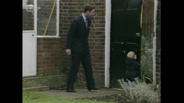 prince william attempts to leave the walled garden at kensington palace, but he is followed by prince charles who closes the garden door, while... - toddler stock videos & royalty-free footage