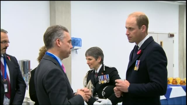 prince william attending police ceremony closeups of police hats / william chatting william walking outside in procession before accepting a shovel... - コミッショナー点の映像素材/bロール