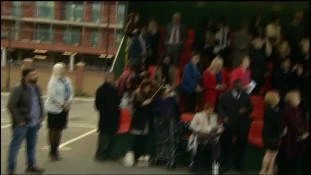 Prince William attending police ceremony Long shot of police standing to attention / audience / Prince William Duke of Cambridge talks to police /...