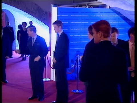 vídeos de stock, filmes e b-roll de prince william attends press complaints commission party bbc pool strong flashlight glare for arrivals london somerset house prince william along on... - bbc
