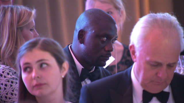 Prince William attends Tusk Trust gala Shows interior shots audience members listening to speech applauding at the end of events on November 24 2015...