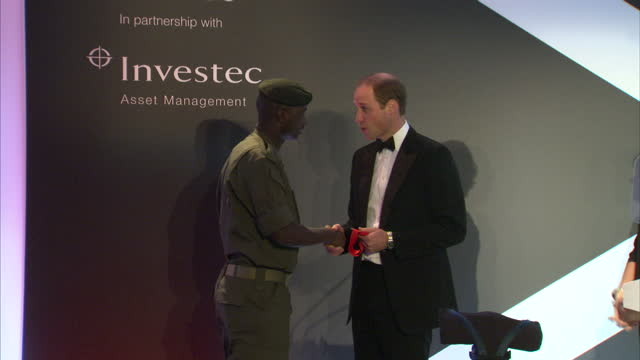 Prince William attends Tusk Trust gala Shows interior shots Edward Ndiritu walking onto the stage being presented his award by Prince William on...