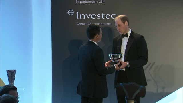 Prince William attends Tusk Trust gala Shows interior shots Prince William presenting award to Emmanuel de Merode on November 24 2015 in London...