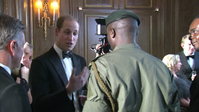 Prince William attends Tusk Trust gala Shows interior shots Prince William talking with Edward Ndiritu on November 24 2015 in London England