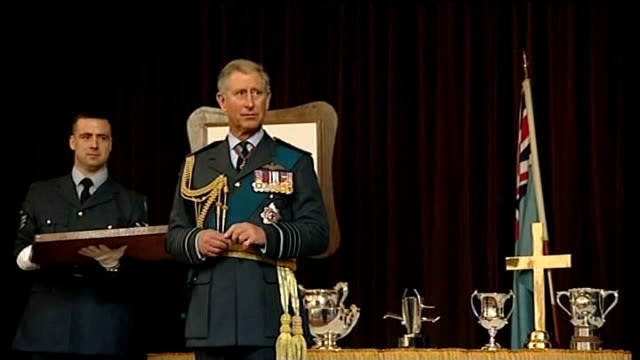 prince william awarded raf pilot's wings by prince charles ***flash prince william along on stage and receives his wings from prince charles and both... - receiving stock videos and b-roll footage