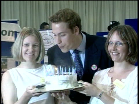 prince william blows out candles on cake held by two girls on trip to anglesey 19 jun 03 - birthday candle stock videos & royalty-free footage