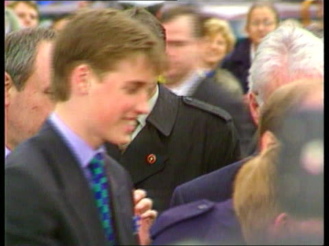 Prince William c1300 Vancouver Prince William accepting flowers from teenage girls during visit to Canada