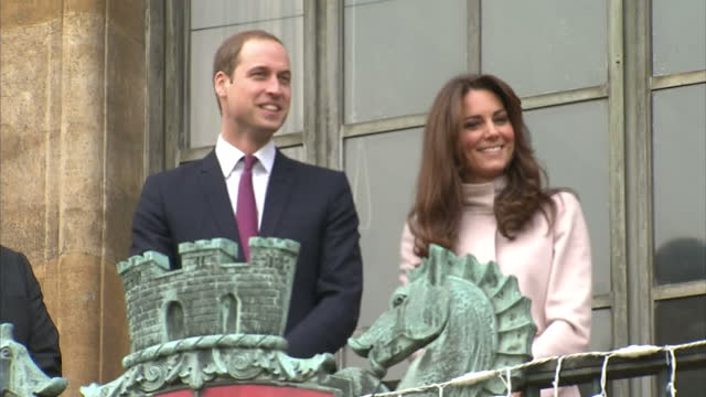 Prince William Catherine Duchess of Cambridge wave from balcony at Cambridge Guildhall Duke Duchess of Cambridge in Cambridge on November 28 2012 in...