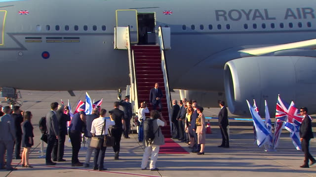prince william disembarking from his plane after arriving in israel and is greeted by israeli politicians - ロイヤルツアー点の映像素材/bロール