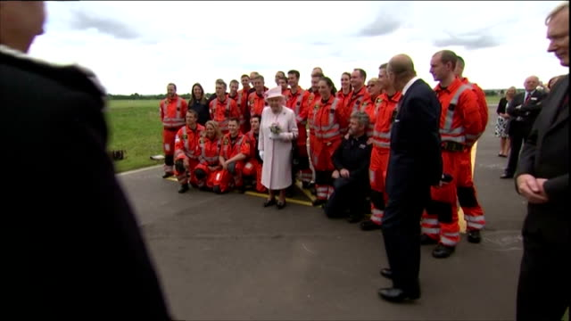 prince william duke of cambridge gave queen elizabeth ii a tour as they opened the new east anglian air ambulance base at cambridge airport the... - herzog von cambridge stock-videos und b-roll-filmmaterial