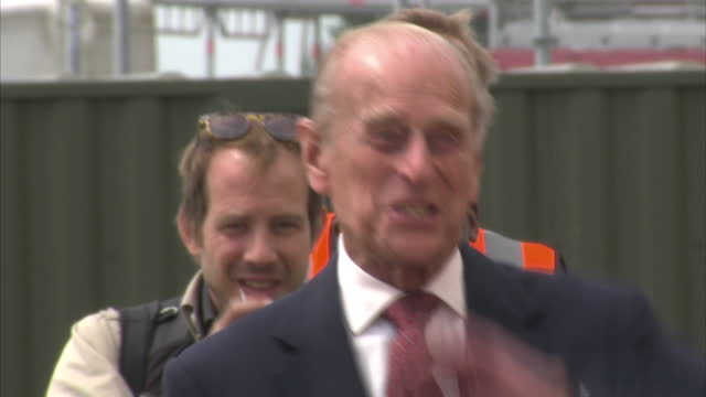 Prince William Duke of Cambridge gave Queen Elizabeth II a tour as they opened the new East Anglian Air Ambulance Base at Cambridge Airport The...