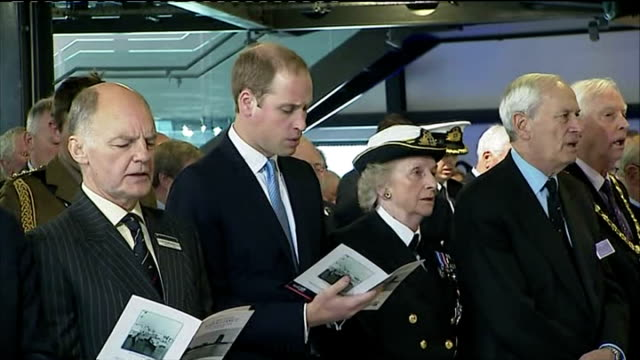 prince william duke of cambridge singing hymns with officials on visit to royal navy submarine museum and shares hymn sheet with relative of navy... - gosport stock videos & royalty-free footage