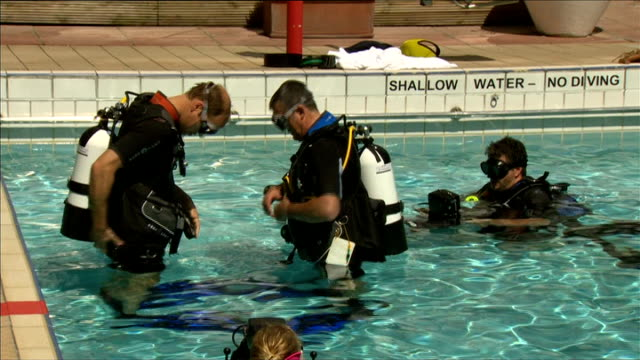 prince william enjoys scuba diving at handover of presidency of sub-aqua club; william in pool, putting on oxygen cannister underwater william... - aqualung diving equipment video stock e b–roll