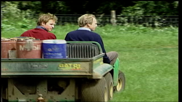 father's farm visit england gloucestershire duchy home farm prince william and man on mini tractor and away 004820 ws field of crops as pan lr ditto - land stock videos & royalty-free footage