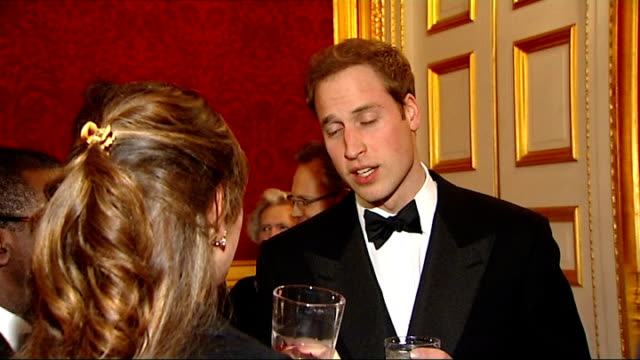 vídeos de stock e filmes b-roll de prince william hosts event for homeless charity 'centrepoint' prince william speech guests at reception / musician jools holland / prince william... - 2009