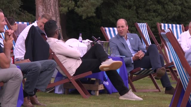 prince william hosts viewing party for the fa cup final; england: norfolk: sandringham: ext prince william, duke of cambridge sat next to romesh... - outdoor chair stock videos & royalty-free footage