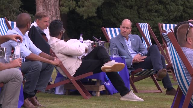 prince william hosts viewing party for the fa cup final; england: norfolk: sandringham: ext prince william, duke of cambridge talking to people at fa... - outdoor chair stock videos & royalty-free footage