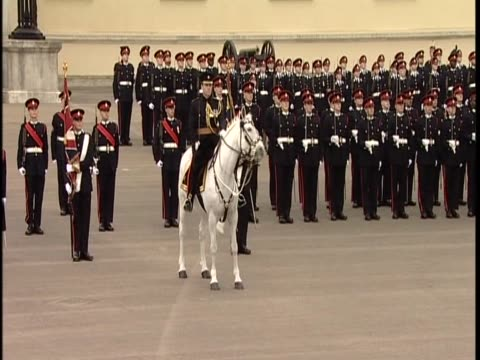 Prince William is watched by his girlfriend Kate Middleton as he passes out from Sandhurst Military Academy