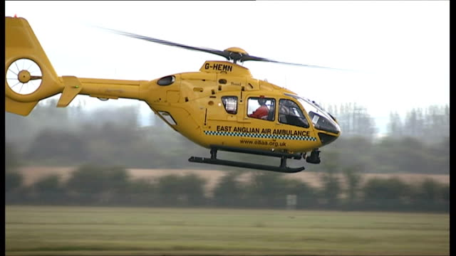 prince william joins east anglia air ambulance service; ext east anglian air ambulance taking off and along in sky gerry hermer interview sot - east anglia stock videos & royalty-free footage