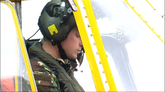 prince william joins east anglia air ambulance service; file: 31.3.2011 / r31031108 wales: anglesey: ext prince william, duke of cambridge, at... - east anglia stock videos & royalty-free footage