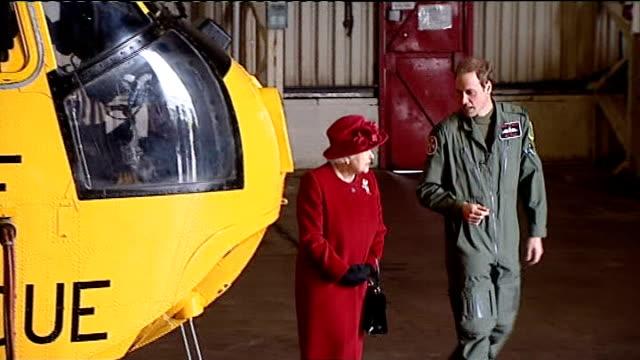 prince william joins east anglia air ambulance service; lib / 1.4.2011 raf valley: int **flashlight photography** prince william showing grandmother... - イーストアングリア点の映像素材/bロール